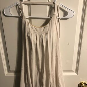 White strappy lululemon tank top with built-in bra